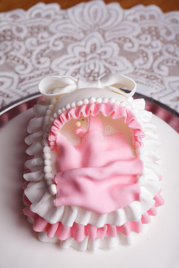 Birthday cake. With mastic and little baby in bed stock photos