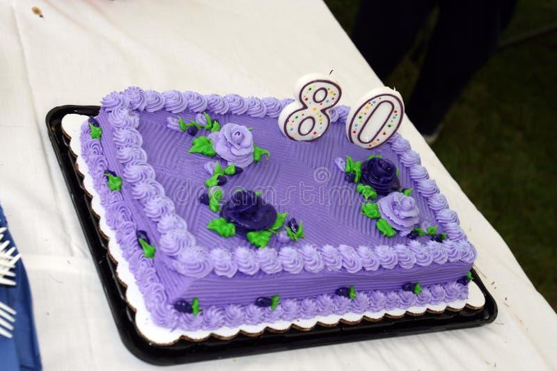Birthday Cake. A purple Birthday cake celebrating an 80th Birthday stock photos