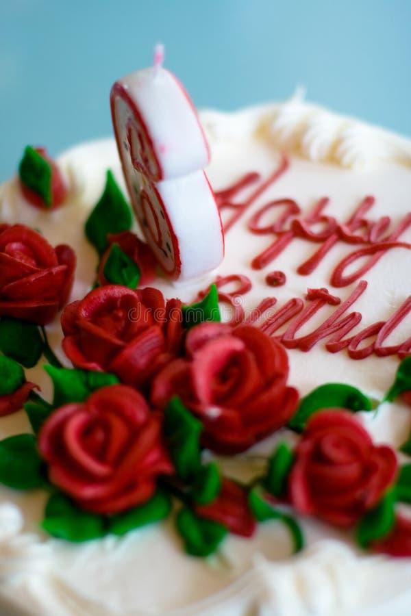 Birthday Cake. 6th birthday cake with roses decorations stock photo