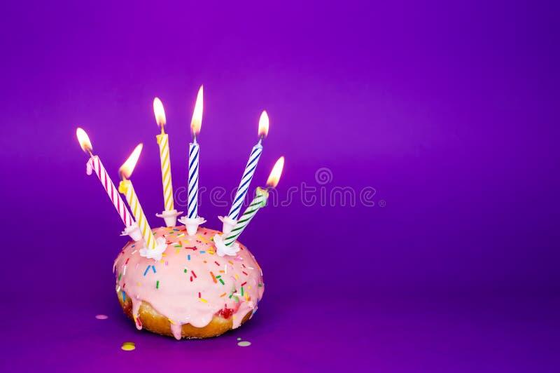 Birthday cake. On purple background royalty free stock image
