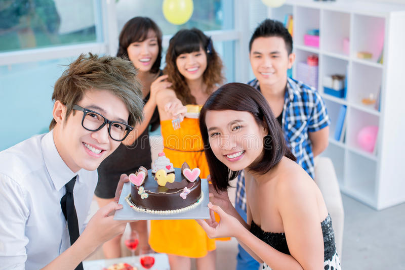 Birthday cake. Happy teenagers showing their birthday cake royalty free stock images