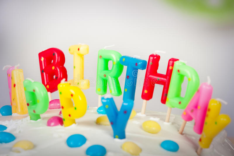 Birthday cake. Party Candles on a Slice of Birthday Cake royalty free stock images