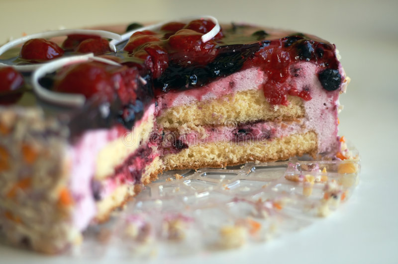 Birthday cake. Delicious birthday cake with blueberries and raspberries royalty free stock images