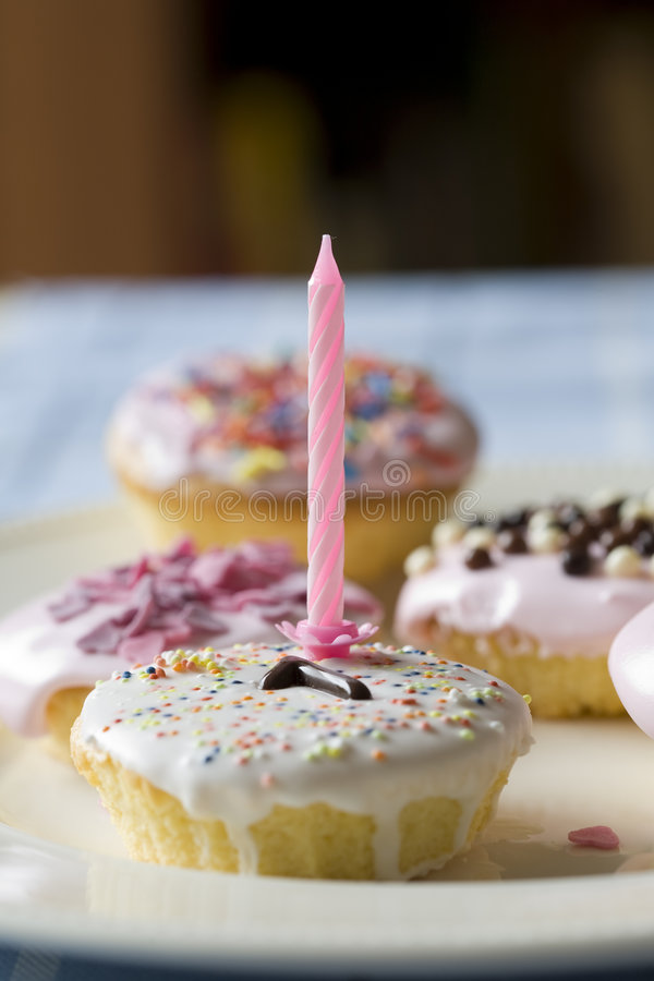 Birthday cake. Small birthday cake with one candle and the number one in chocolate stock photography