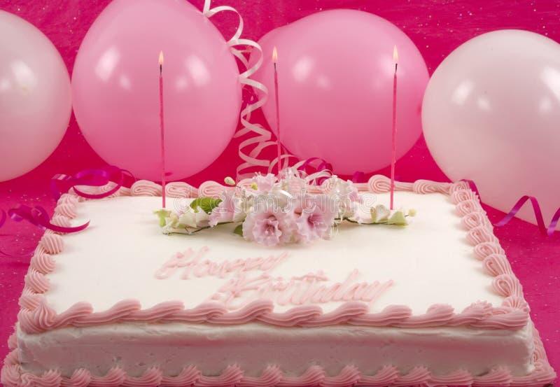 Birthday Cake. Delicious beautifully decorated birthday cake and balloons stock photos