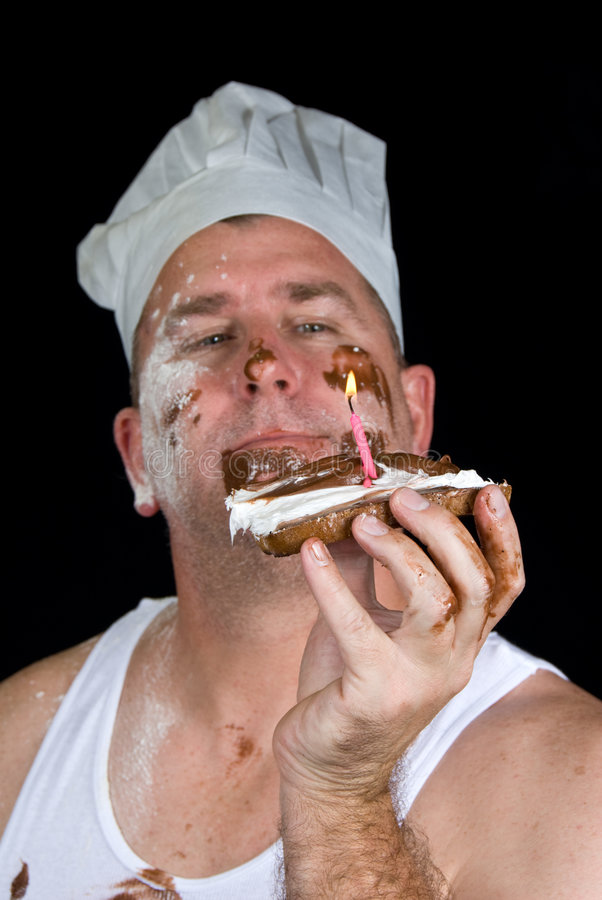 Birthday cake. A chef examines his gourmet birthday creation consisting of burnt toast, chocolate and vanilla icing and a candle stock photos