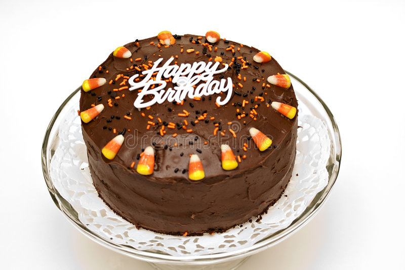Birthday cake. Fall chocolate birthday cake with sprinkles and candy corn stock photography