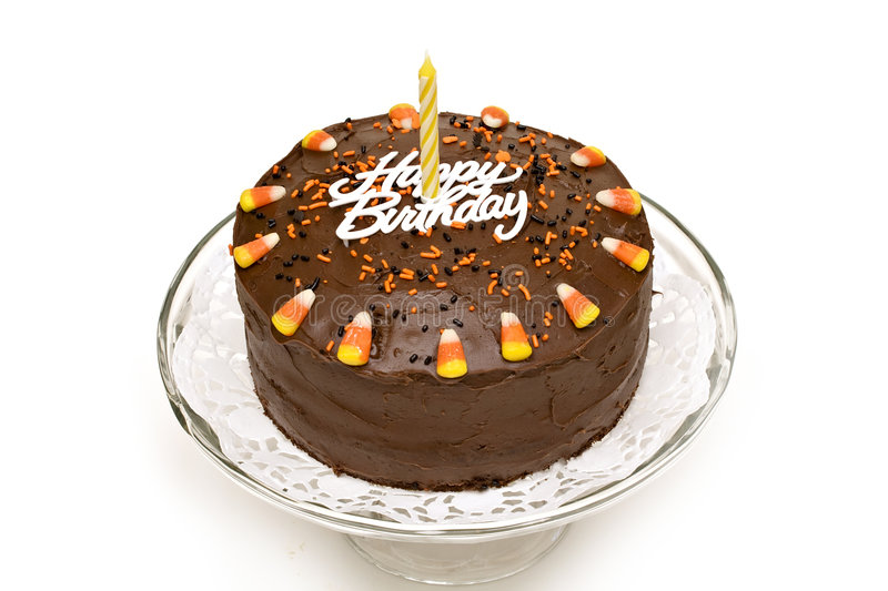 Birthday Cake. Fall chocolate birthday cake with sprinkles and candy corn royalty free stock image