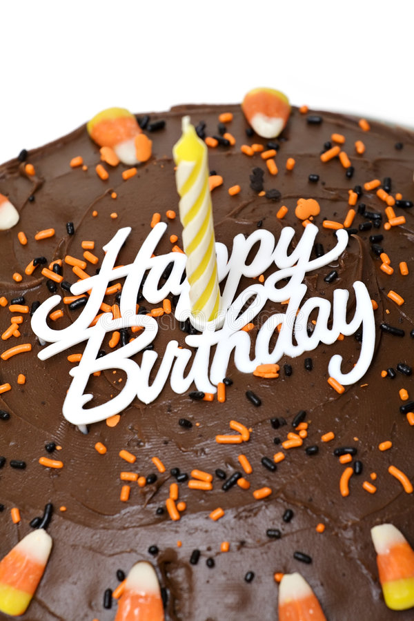 Birthday Cake. Fall chocolate birthday cake with sprinkles and candy corn stock photos