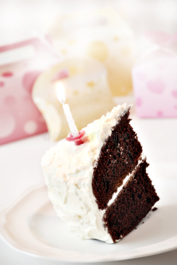 Birthday cake. Chocolate birthday cake with candle and presents royalty free stock image