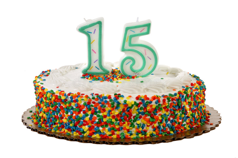 Birthday Cake. White iced sprinkle covered anniversary or birthday cake with number 15 candles on it stock photo