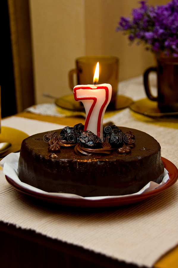 Birthday cake. With figure-shaped candle stock photo