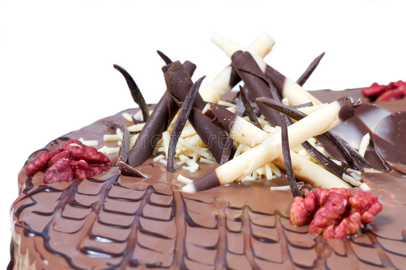 Birthday cake. Detail of birthday cake with walnuts and decoration on white background stock photo