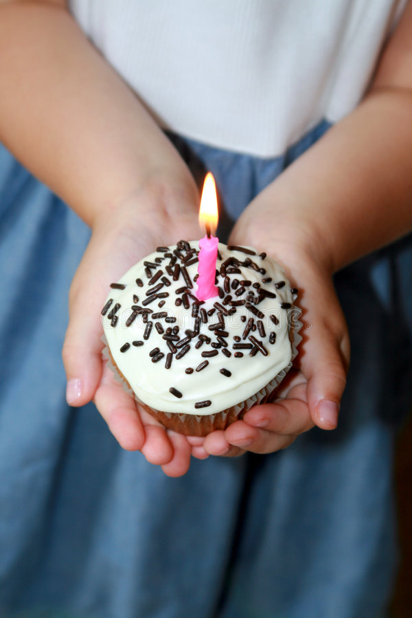 Birthday Cake. A little girl holding a birthday cake with a candle on it royalty free stock image