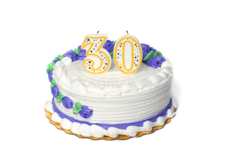 Birthday Cake. A white birthday cake with a three and a zero candle on a white background stock images