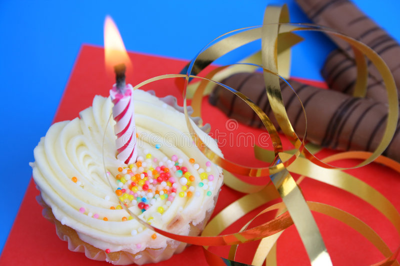 Birthday Cake. With golden ribbon and a candle stock images