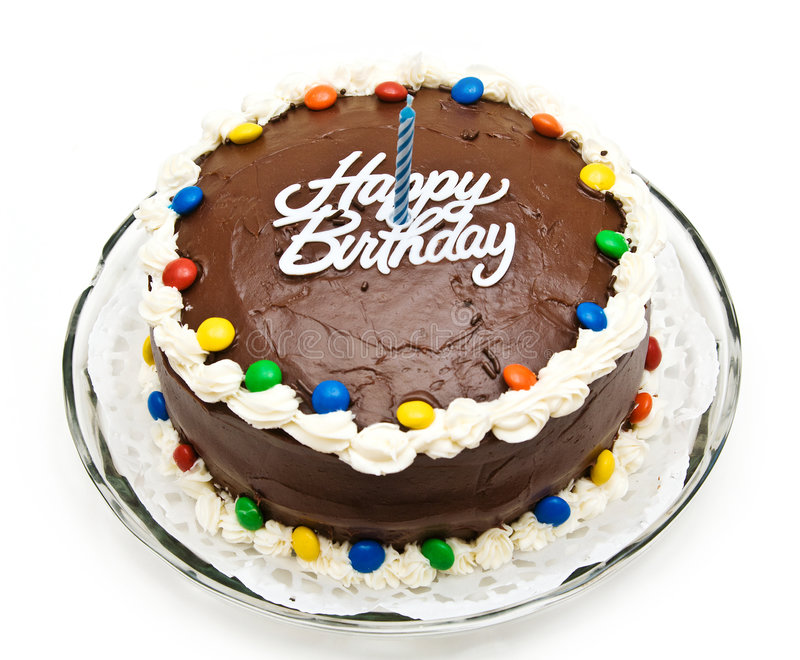 Birthday Cake. A chocolate birthday cake with candy, candle and icing stock photos