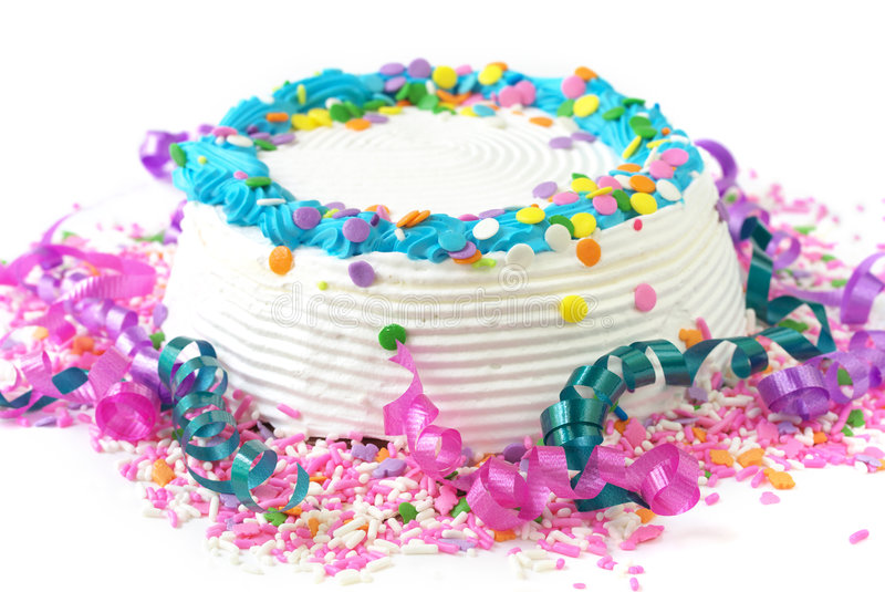 Birthday cake. With sprinkles and streamers royalty free stock photo