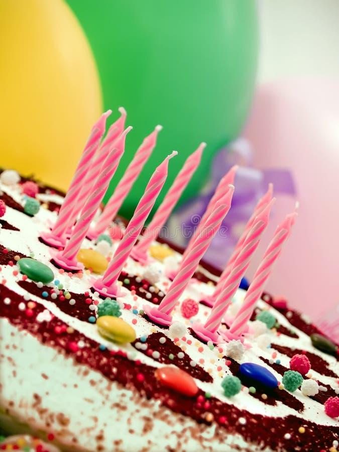 Birthday cake. Colorful birthday cake, balloons at background stock photos