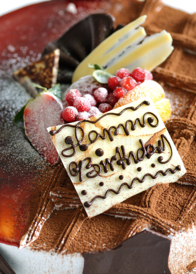Birthday cake. With chocolate and fruit toppings stock photo