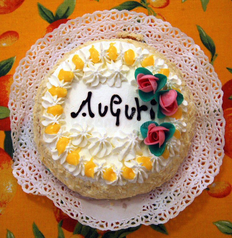 Birthday cake. With auguri and little roses royalty free stock image