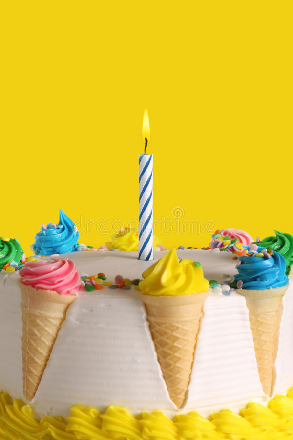 Birthday cake. With a single blue candle royalty free stock photos
