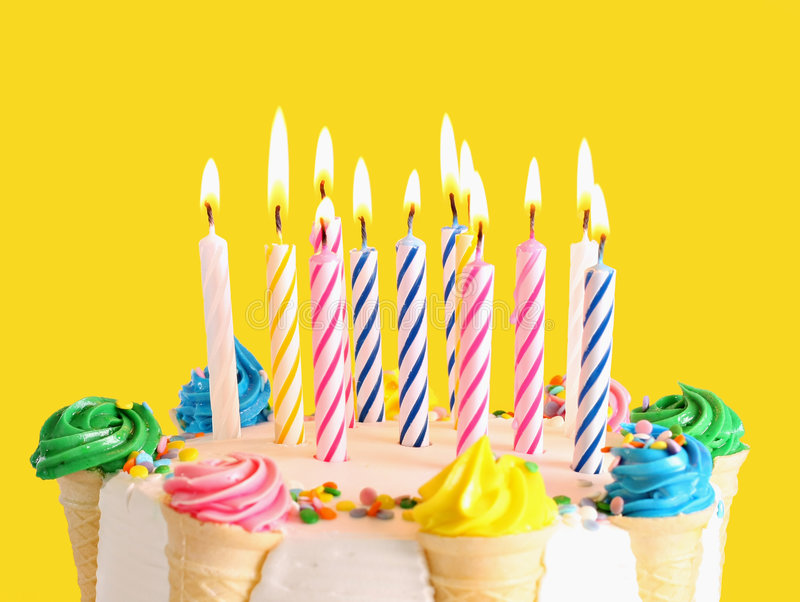 Birthday cake. With many candles. Focus on the middle candles royalty free stock photos