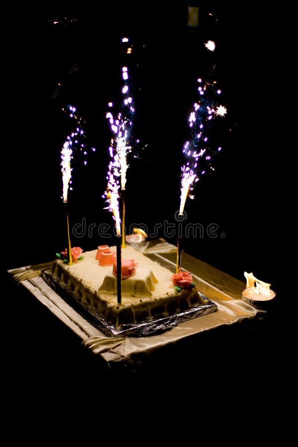 Birthday cake. With burning candles, black background royalty free stock image