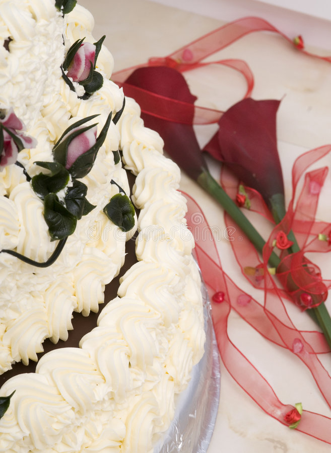 Birthday cake. Detail of birthday cake with flowers and ribbon royalty free stock image