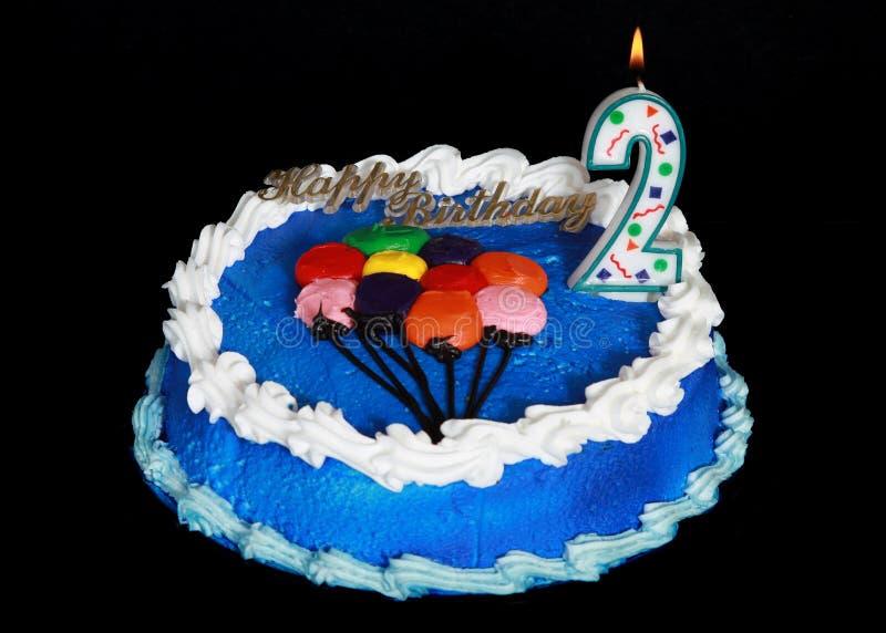 Birthday cake. On a black background royalty free stock photo