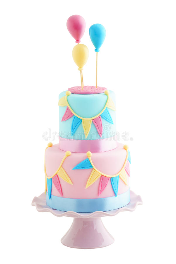 Birthday cake with balloons. Fondant covered pastels coloured birthday cake with buntings and balloons iolated on white royalty free stock images