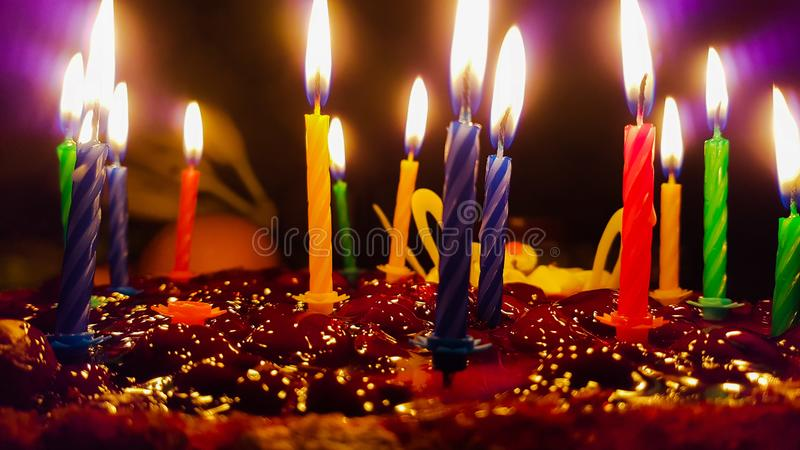 Birthday cake. Beautiful birthday sweet cake with cilorful candles royalty free stock images