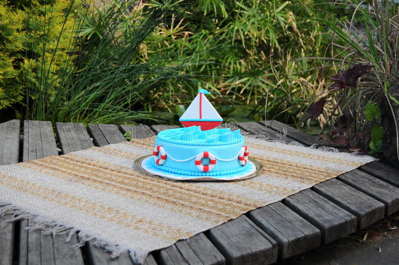 Birthday cake. Beautiful birthday cake. Very bright and tasty. Marine theme. Cute boat stock photo