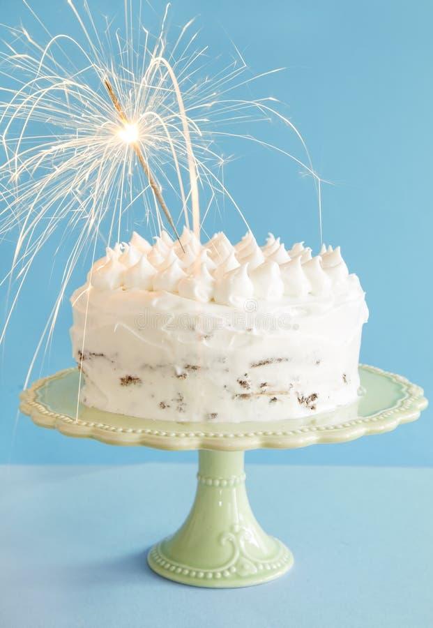 Birthday cake. On blue background stock photography