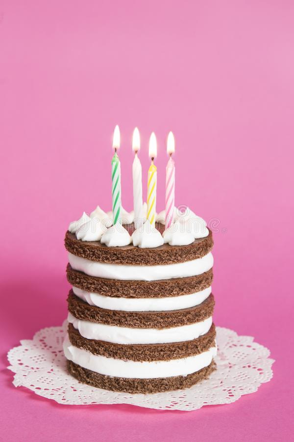 Birthday cake. With the burning candles stock photography