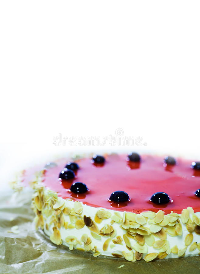 Birthday cake with black cherry, red jelly, almond flakes. White background, copy space. Dessert menu design template. Birthday cake with black cherry, red stock images