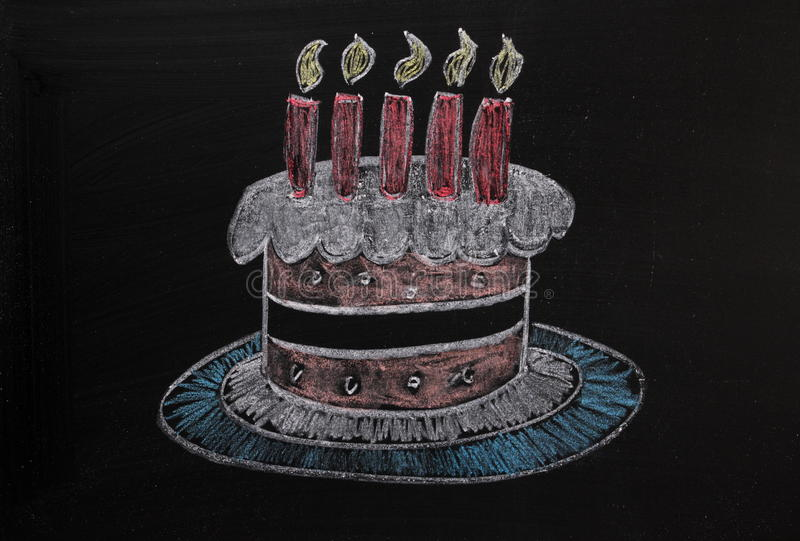 Birthday Cake on a Blackboard. Chalk drawing in colour of a birthday or celebration cake on a used blackboard royalty free stock image