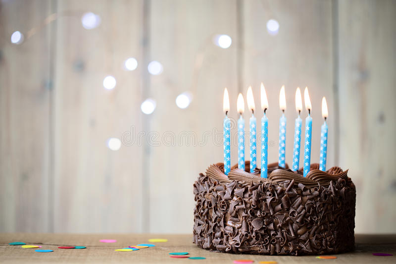Birthday cake. With blue candles stock photos