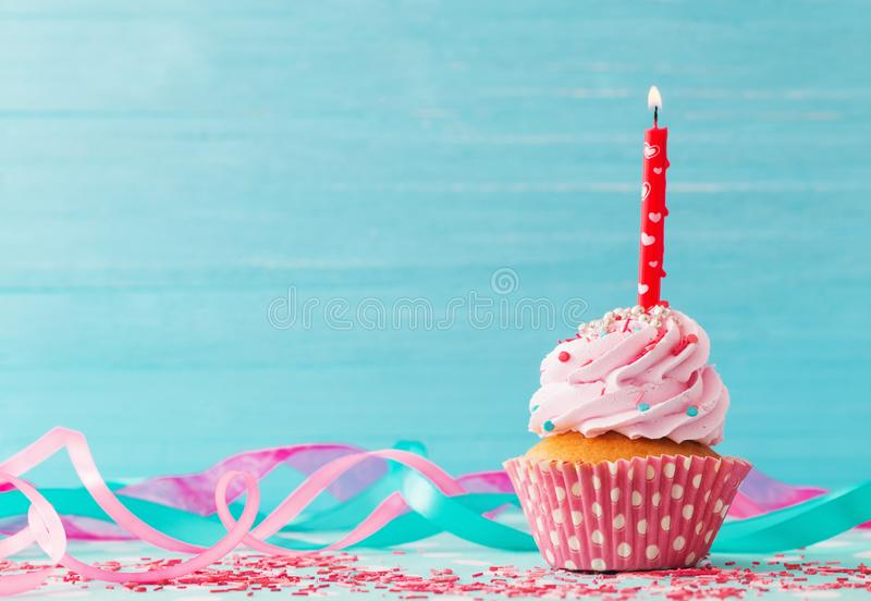 Birthday cake on blue wooden background. The birthday cake on blue wooden background stock photography