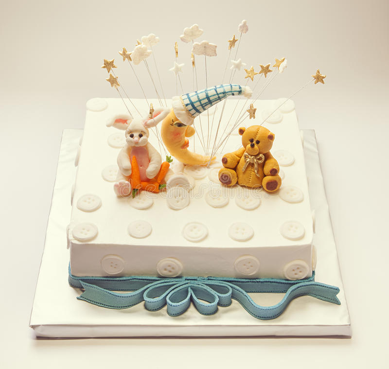 Birthday Cake. For a boy, funny decoration with buttons and animals made of sugar royalty free stock images