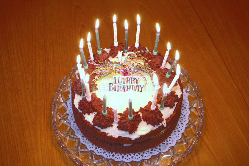 Birthday Cake - burning. A Happy Birthday Cake with candles - alight royalty free stock photography
