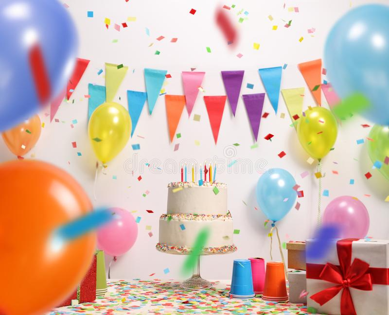 Birthday cake with burning candles royalty free stock photos