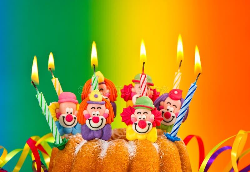 Birthday cake with burning candles decoration royalty free stock photos