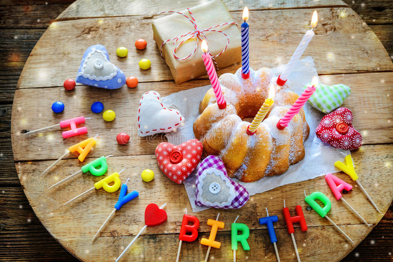 Birthday cake with burning candles stock photo