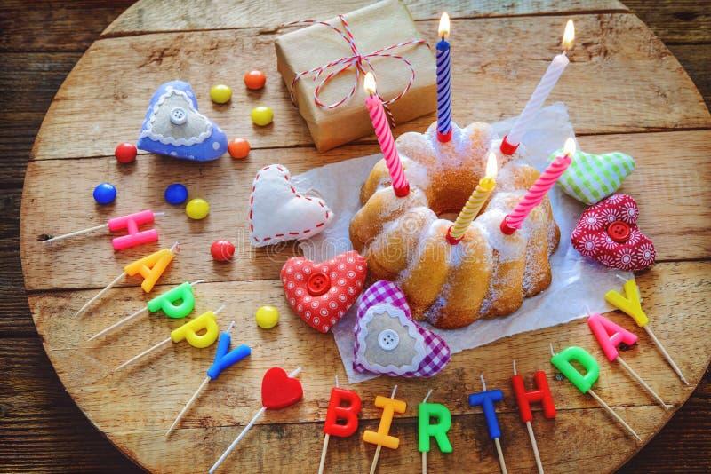 Birthday cake with burning candles stock photos