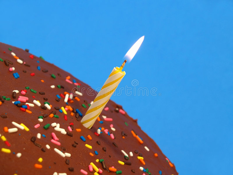 Birthday cake with candle. (over blue stock image