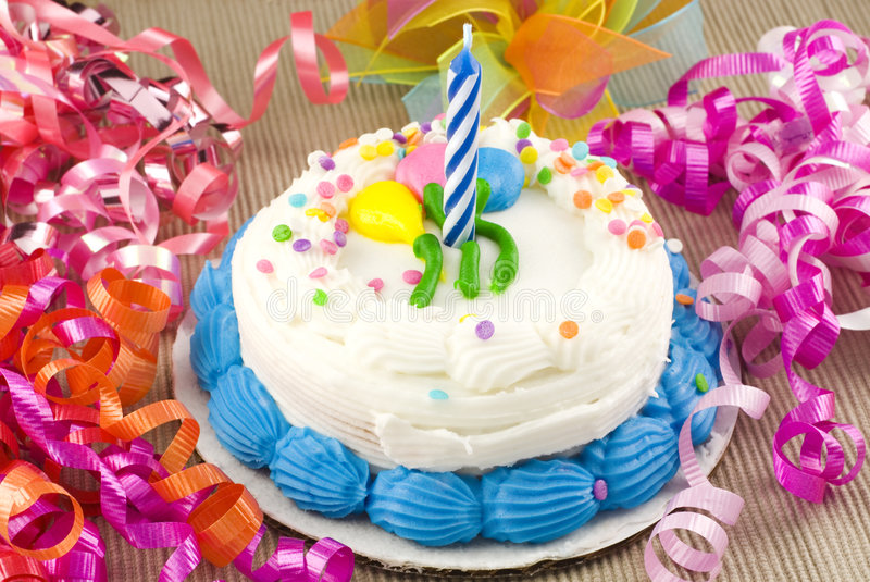 Birthday Cake with Candle. Birthday cake with one candle and curly ribbon stock photos