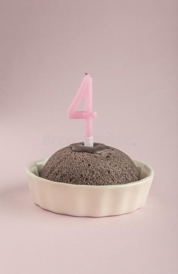 Birthday cake with candle age four royalty free stock image