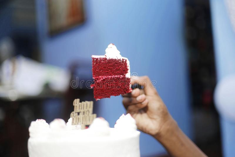 Birthday cake with candle. Lit in dark background stock photography