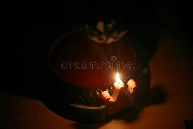 Birthday cake with candle. Lit in dark background stock photos